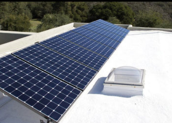 Flat roof with skylight and solar panels protect by Armstrong spf insulation